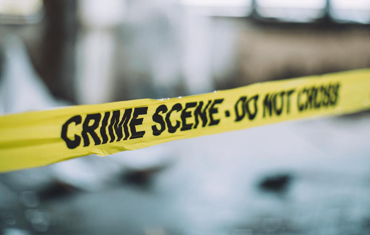 "Yellow police tape reads, ""Crime scene. Do not cross."""